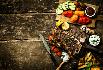 Colorful roast vegetables and grilled t-bone steak