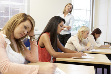 Students and tutor in exam