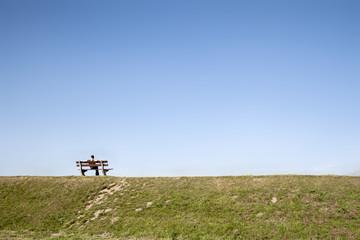 man alone in an empty field