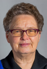 Head of senior woman wearing glasses