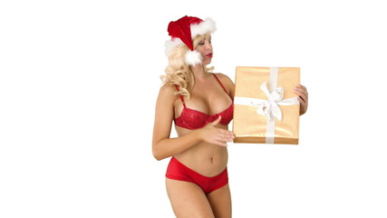 Sexy young girl in Santa hat with present and blowing kisses
