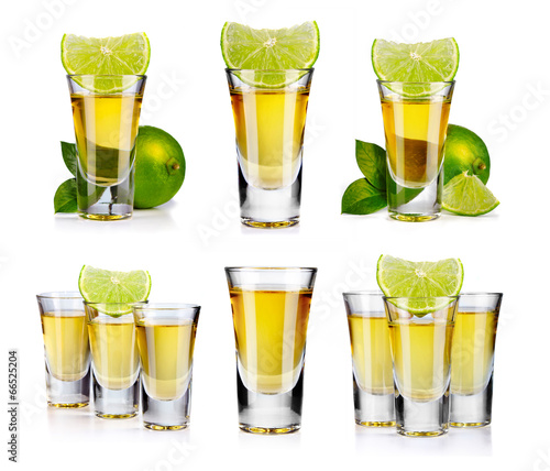 Set of gold tequila shot with lime fruits isolated - 66525204