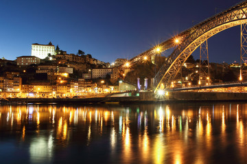 Dom Luis bridge and Porto at dusk