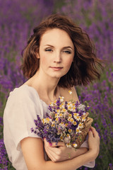 Smiling beautiful brunette in the lavender field