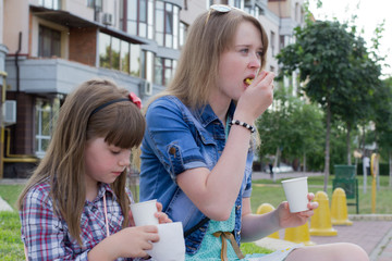 two girls on the street snack