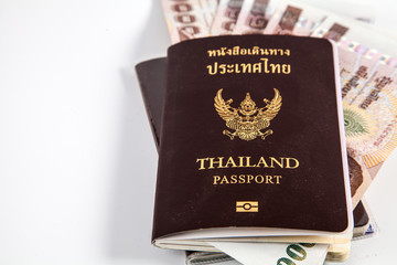Thailand passport with Thai money and free left space