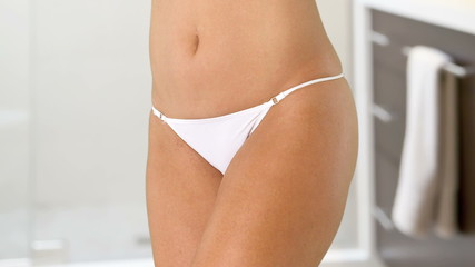 Woman's torso with white bikini underwear