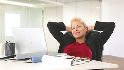 Executive businesswoman relaxing at desk