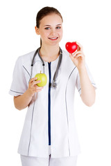 Smiling doctor with a green apple and red heart.