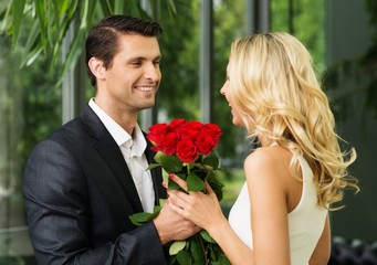 Handsome man with bunch of red dating his lady