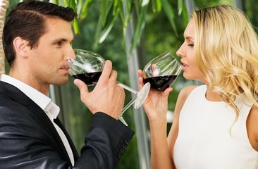 Couple with glasses of red wine in restaurant