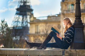 Beautiful woman in Paris, reading a book