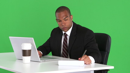 Male executive at desk with laptop