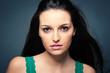 Beautiful brunette woman close up portrait.