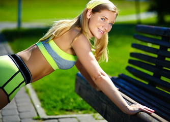 woman doing push ups in outdoor workout training