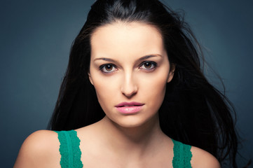 Beautiful brunette woman close up portrait.