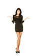 Woman in black dress presenting copy space