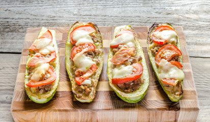 Stuffed zucchini on the wooden board