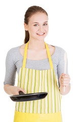 Smiling woman with the frying pan