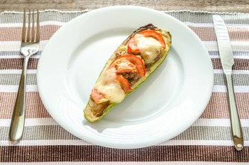 Stuffed zucchini on the plate