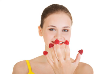 Smiling casual woman with raspberries