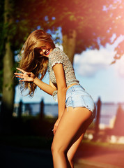 sexy stylish smiling girl model in casual cloth in jeans