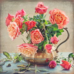 Still life with a fresh roses in a vintage jug .