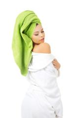 Beautiful spa woman in bathrobe.