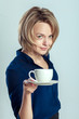 smiling woman with coffee or tea cup