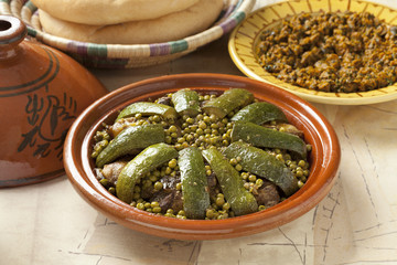 Moroccan dish with lamb, peas and courgette