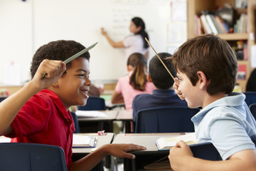 Schoolboys behaving badly in class