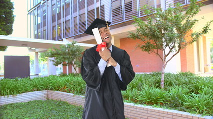 African American man with graduation gown and diploma