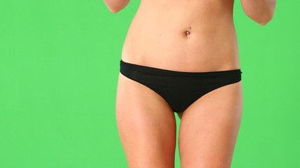 Close up of young woman with black underwear