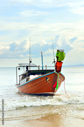 Longtail boat on a beach - 66534029
