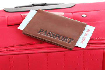 Passport and ticket on suitecase close-up