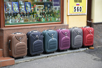 Color suitcases are on sale on the street in Karlovy Vary, the C