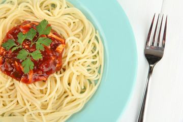 Italian spaghetti in plate on wooden table