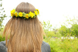 Female hair with crown of dandelions