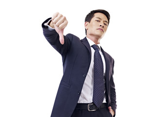 asian businessman thumb down, isolated on white