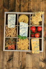 Italian products in wooden box on table close-up
