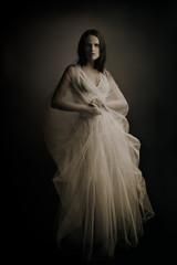 Fashion model in white long dress