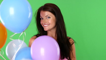 Closeup of young woman playing with balloons