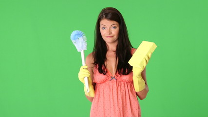 Cute young woman holding toilet brush and sponge