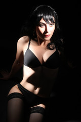 Sensual woman in lingerie on black