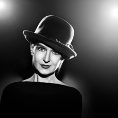 Woman in elegant hat Black and white portrait