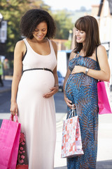 Pregnant women out shopping