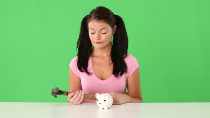 Young woman and piggy bank