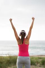 Fitness female athlete celebrating exercising achievement