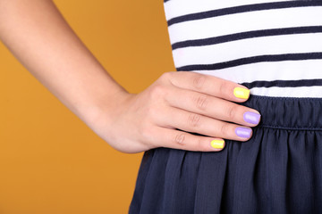 Female hand with stylish colorful nails, close-up,