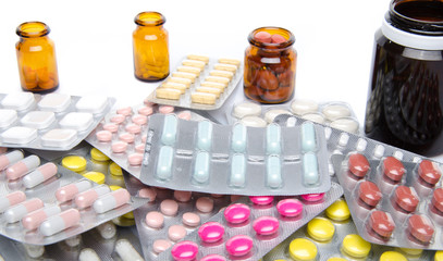 Pills, tablets and capsules in blister packs and bottles